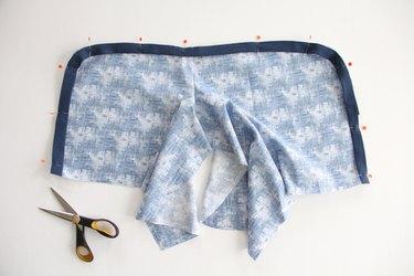 Sew bias tape to curved leg seams