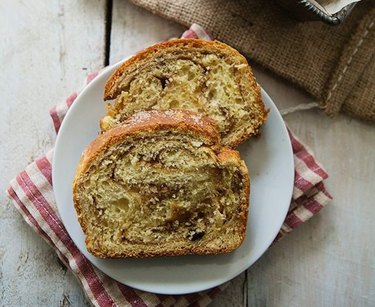 Two slices of cinnamon swirl bread on a white plate