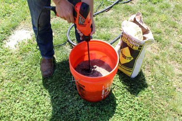 mix concrete and water with paddle attachment and drill