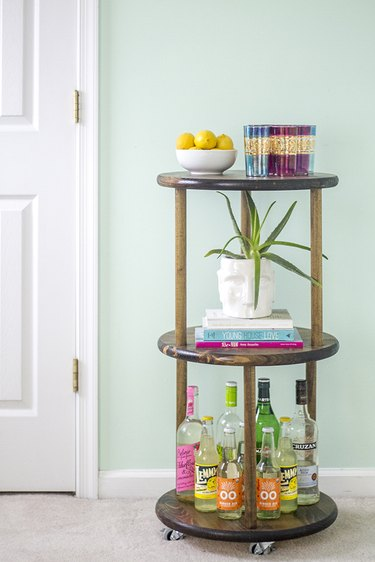 Learn how to make your own solid wood rolling bar cart.