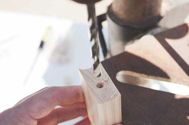Drilling a hole into the cross brace