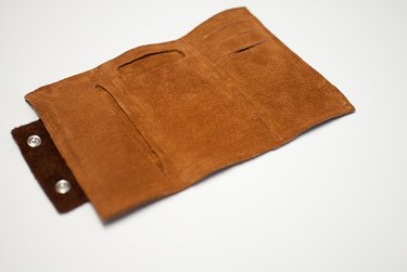 inside wallet with slits for phone and credit cards