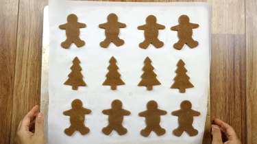 Unbaked gluten-free, low carb gingerbread cookies on parchment-line baking sheet.