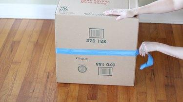 Taping bottom of box
