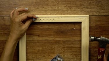 Hammering wire nails to make DIY simple frame loom.