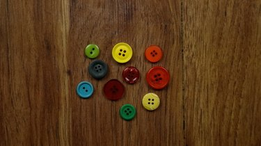 Assorted colors and sizes of buttons for Christmas ornament gift tags
