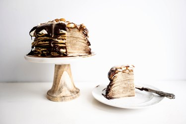 Slice and enjoy your Dark Chocolate and Caramel Crepe Cake.