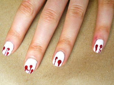 Lines of polish going from the tips of the nails to the center of the dots.
