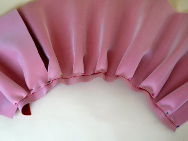 The entire waist line pinned with pleats.