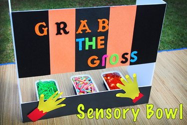 sensory bowls filled with candy hidden behind a panel