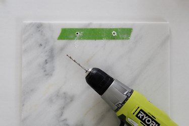 Drill holes through the marble at the marks