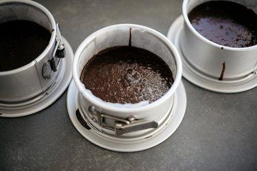 Divide the batter between the cake tins set aside above.