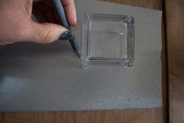 Draw outline of vessel onto aluminum sheet