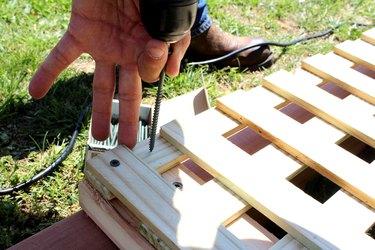 "drill 4"" deck screws through lattice and post"