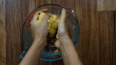 Mixing ingredients with hands for almond flour no-roll gluten-free low-carb pie crust.