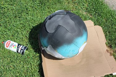 Paint the globe with black spray paint.