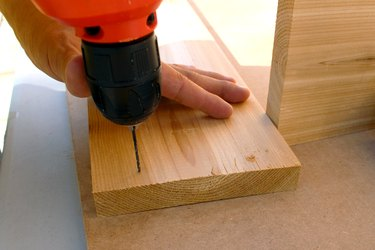 drill pilot holes, two holes per corner | how to make an elevated planter box