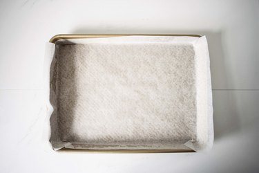 A greased and lined rimmed baking tray.