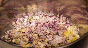 Saute vegetables on medium high heat.