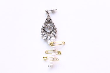 Attach safety pins to the pearl chain