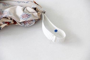Sew elastic ends together