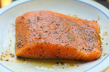 salmon on a plate with olive oil and spice rub