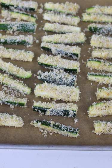 zucchini fries on parchment