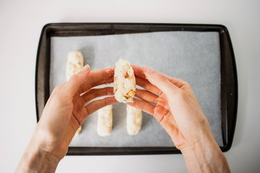 Hands shaping the croquettes.