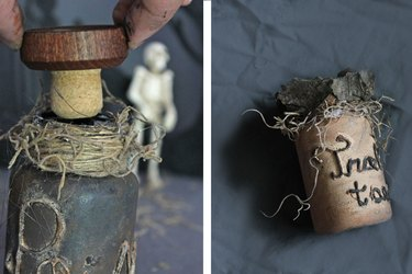 Place a cork in the top of the bottle or decorate the cap with tree bark