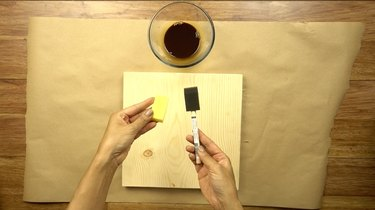 Paint sponges for applying coffee wood stain.
