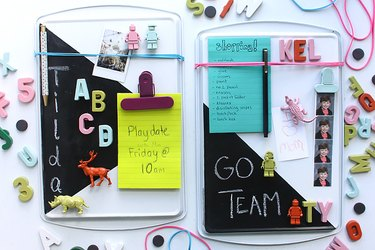 cookie sheet memo board decorated with magnets and a chalkboard