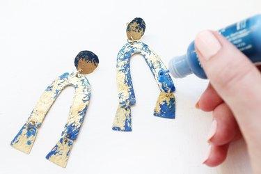 Add blue patina to brass earrings