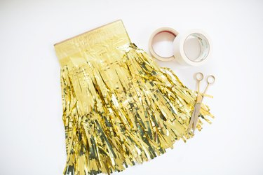 Gold fringe garland with scissors and tape