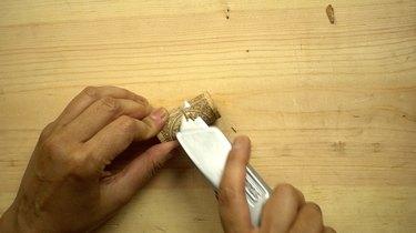 Preparing cork for DIY glass beaded garden sparkler.