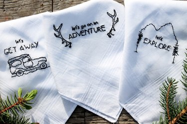 three embroidered handkerchiefs