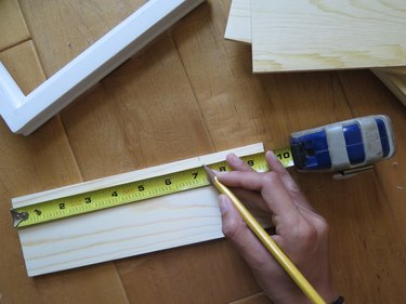 Take your measurement and mark it on the wood board.