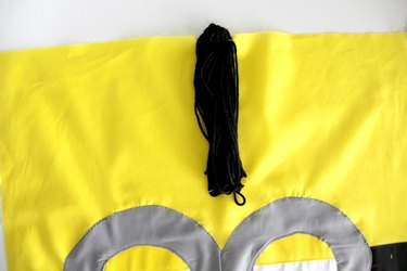 Pin the bottom of the minion hair loop in place
