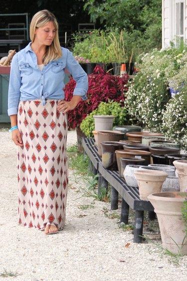 Woman wearing a maxi skirt at an outdoor gardening supply store