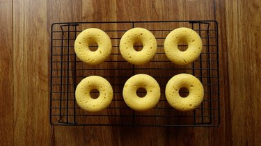 Healthy coconut flour low carb donuts on wire baking rack.