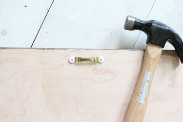 Add hangers to the back of the headboard