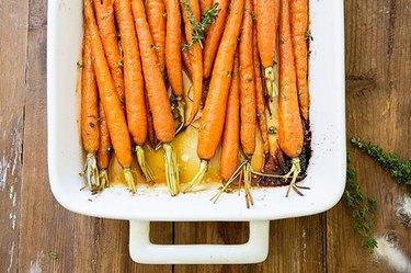 Bright orange honey and rum glazed carrots.