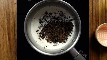 Adding chocolate to milk and half & half in saucepan for low-carb, drinking chocolate.