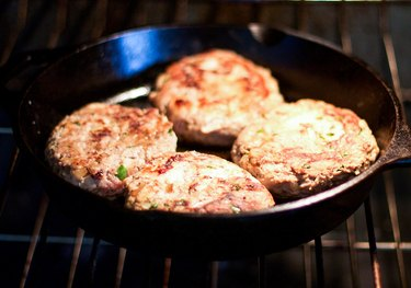 Baking the Turkey Burgers until they are cooked through.