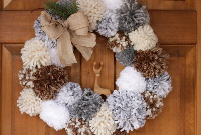 'Tis the season to make a cozy yuletide statement with this fuzzy pom pom wreath that you made yourself.