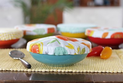 Get rid of the trash producing plastic wrap and create some colorful, reusable fabric bowl covers for all of your summer get togethers.
