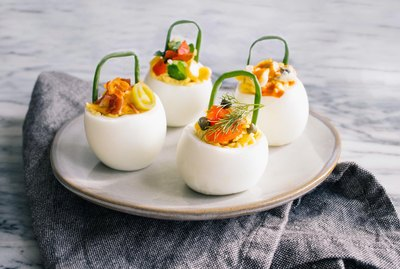 DIY deviled eggs with chive handles and gourmet toppings