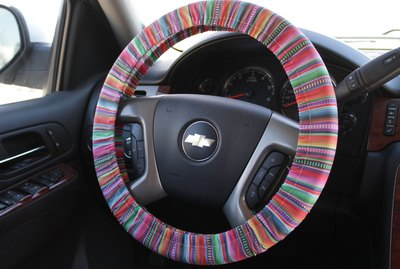 Adorn the interior of your car with a colorful, handmade steering wheel cover.