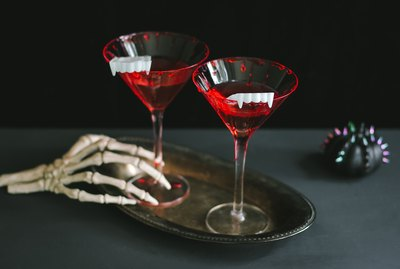 Bloody vampire cocktails with fangs as garnish