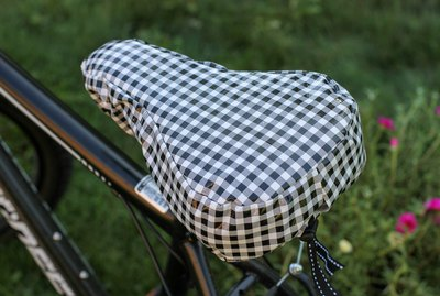 Once you've spent time finding the perfect bike seat for you, protect it from the elements with this oil cloth bike seat cover.