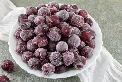 Frozen grapes in a white bowl